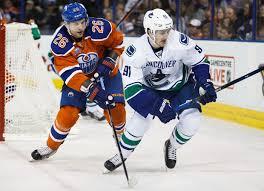 Iiro Pakarinen #26 of the Edmonton Oilers pursues Jared McCann #91 ...