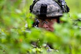 Army Pfc. Dustin Dean pulls security behind a machine gun while the rest of  his platoon