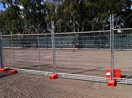 Razor Wires Are Attached At The Top Of Temporary Fencing Fence Panels For Sale Fence Panels Shade Cloth
