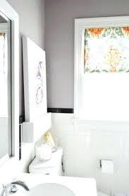 wood frame around bathroom mirror