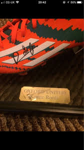 signed football boot in a glass case