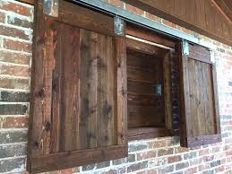 barn door style outdoor tv cabinet