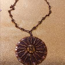 large copper stylized sun necklace