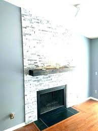 stone fireplace with shiplap walls