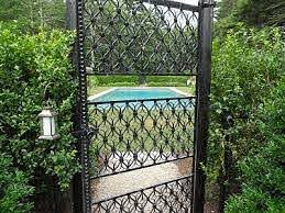 Black Chain Link Fence Disguised By Shrubbery Coupled W Nice Wrought Iron Gates Wonder How Much Black Chain Link Fence Fence Landscaping Garden Fence Panels