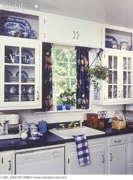 white cabinets blue laminate counter