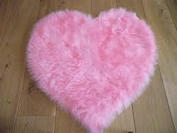 pink cupid heart shaped rug 75 x 75 cm