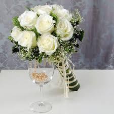 لتتألقي في زفافك إليك اجمل مسكات عروس ورد طبيعي Yasmina