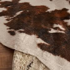 binx faux cowhide beige brown area rug