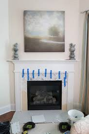 tile over a marble fireplace surround