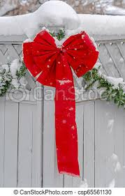 White Fence With Vibrant Red Ribbon And Garland A White Wooden Fence Decorated With A Vibrant Red Ribbon And Plain Green