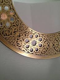 mirror with an arabic brass frame