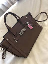 large brown leather coach handbag