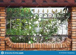 Beautiful Brick And Metal Fence With Door And Gate Of Modern Style Design Metal Fence Ideas Front View Stock Photo Image Of Frame Exterior 137318152