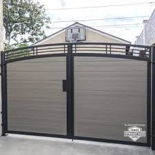 Steel Framed Vinyl Gate Another Of Our Horizontal Gates With Walnut Vinyl Inserts We Recently Completed House Gate Design Door Gate Design Gate Designs Modern