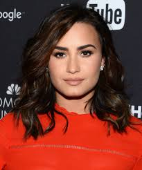 demi lovato embraces freckles instyle
