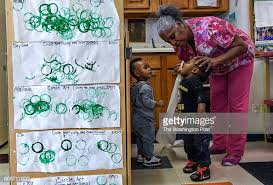 Childcare worker Debbie James-Dean cleans the face of Aaron... News Photo -  Getty Images
