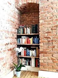 shelves on brick wall shelves on brick