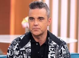 Robbie Williams admits he couldn't get off his sofa for THREE YEARS