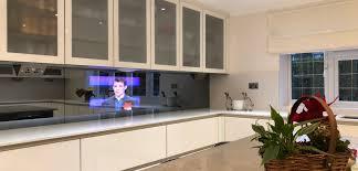 32 mirror tv in a kitchen splash back