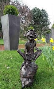 pixie on snail antique bronze sculpture