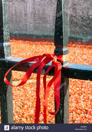 Red Ribbon Tied To Metal Fence Tower Of London Poppy Exhibition 2014 Stock Photo Alamy
