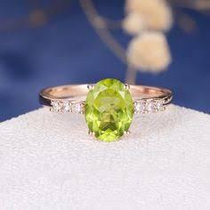 "Image result for https://gemsandjewelsforless.com/collections/peridot-rings"""