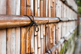 Kyoto Japan Residential Area With Closeup Of Bamboo Wooden Fence With Red Orange Brown Color By Sidewalk With String Or Rope Tied By Japanese Garden Stock Photo Download Image Now Istock
