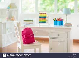 Kids Bedroom With Wooden Desk And Doll House White Sunny Room With Big Window For Young Child Home Interior For Little Girl Table For Homework And Stock Photo Alamy