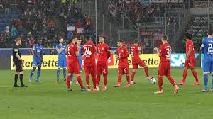 Bayern and Hoffenheim players stand against their ultras ...
