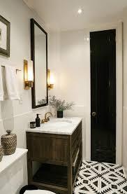 narrow bathroom with black linen closet