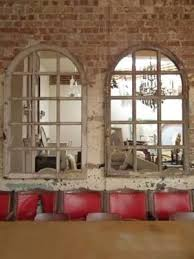 arched mirrors that look like windows