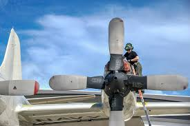 Picture of the Day: Navy Petty Officer 2nd Class Melissa Ellis Fastens a  Propeller on a P-3C Orion | SOFREP