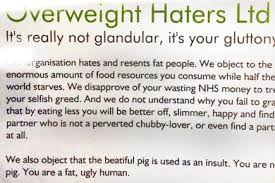 Passengers handed 'fat-shaming' cards on London tube - news