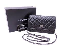 chanel black patent leather wallet on a