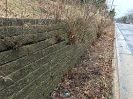 how can i fix my falling retaining wall