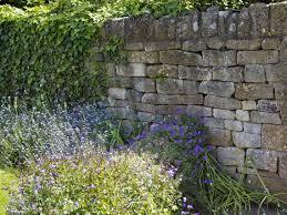 13 Garden Wall Ideas That Will Create A Blissful Outdoor Oasis Bidvine