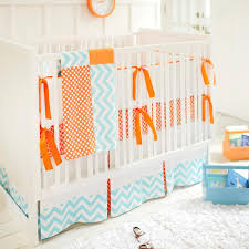blue and orange crib bedding in nursery