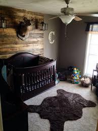 Hunting Lodge Nursery With Pallet Wall Deer Mount Bear Rug And Lanterns Nursery Room Boy Rustic Baby Nurseries Baby Boy Themes