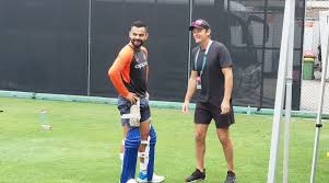 Virat Kohli catches up with Adam Gilchrist during training at The Gabba