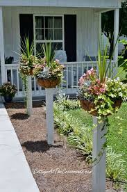 How To Mount Flower Baskets Onto Wooden Posts Garden Projects Front Yard Plants