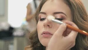 makeup artist making make up for stock