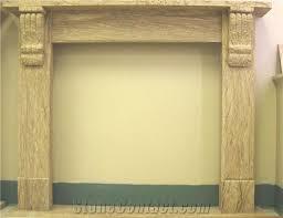 beige sandstone fireplace mantel from