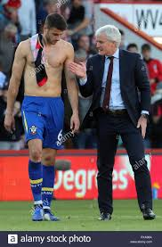 Southampton's Wesley Hoedt (left) and manager Mark Hughes after the final  whistle during the Premier League match at the Vitality Stadium,  Bournemouth Stock Photo - Alamy