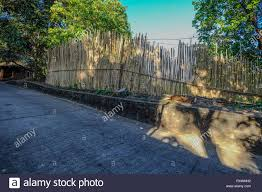 Rural Road With Bamboo Fence On Coron Island Philippines Stock Photo Alamy