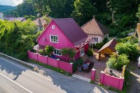 A Nice Pink House With A High Fence And A Wooden Gazebo In The Yard Royalty Free Images Photos And Pictures