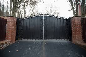 Metal Driveway Gate With Solid Panels Add Privacy Beautiful Ivy Inlay Details Soften The Look Driveway Gate Metal Driveway Gates Wrought Iron Driveway Gates