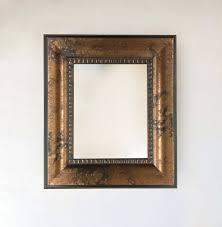 bronze marble framed wall mirror inside