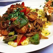 shrimp and homemade chorizo on hominy