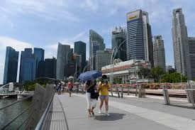 Coronavirus: Singapore PM says pandemic could last a year but city ...